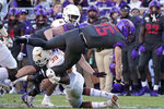TCU quarterback Max Duggan (15) is tackled by Texas defensive back Montrell Estell (39) in the second half of an NCAA college football game in Fort Worth, Texas, Saturday, Oct. 26, 2019. (AP Photo/Louis DeLuca)