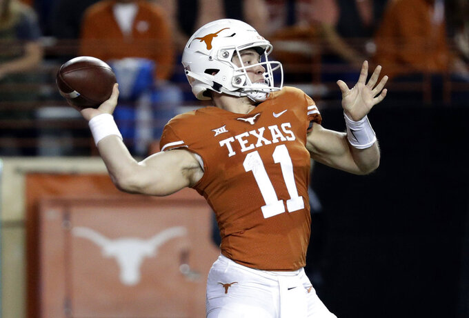 Texas quarterback Sam Ehlinger (11) throws against Iowa State during the first half of an NCAA college football game, Saturday, Nov. 17, 2018, in Austin, Texas. (AP Photo/Eric Gay)