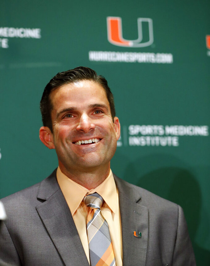 Manny Diaz smiles as he answers questions during a news conference before being introduced as Miami's new NCAA college football head coach, Wednesday, Jan. 2, 2019, in Coral Gables, Fla. (AP Photo/Wilfredo Lee)