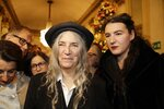 Musician Patti Smith arrives with her daughter Jesse Smith, right, for the gala premiere of La Scala opera house, in Milan, Italy, Saturday, Dec. 7, 2019. Milan's storied La Scala opens its 2019-2020 season on Saturday with Puccini's