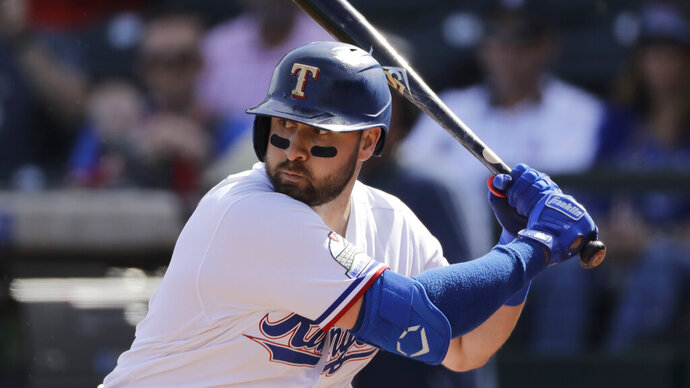 Texas Rangers' Joey Gallo bats during the first inning of a spring training baseball game against the Chicago Cubs Thursday, Feb. 27, 2020, in Surprise, Ariz. (AP Photo/Charlie Riedel)