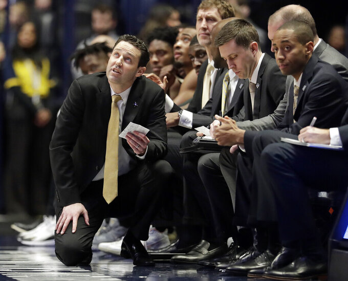 Vanderbilt coach Bryce Drew looks at the scoreboard during the second half of the team's NCAA college basketball game against Texas A&M at the Southeastern Conference tournament Wednesday, March 13, 2019, in Nashville, Tenn. Texas A&M won 69-52. (AP Photo/Mark Humphrey)
