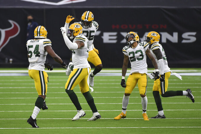 Members of the Green Bay Packers celebrate during the second half of an NFL football game against the Houston Texans Sunday, Oct. 25, 2020, in Houston. (AP Photo/Eric Christian Smith)