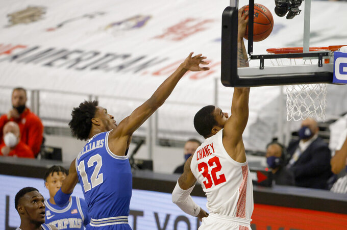 Houston forward Reggie Chaney (32) goes up to dunk as Memphis forward DeAndre Williams (12) defends during the first half of an NCAA college basketball game in the semifinal round of the American Athletic Conference men's tournament Saturday, March 13, 2021, in Fort Worth, Texas. (AP Photo/Ron Jenkins)