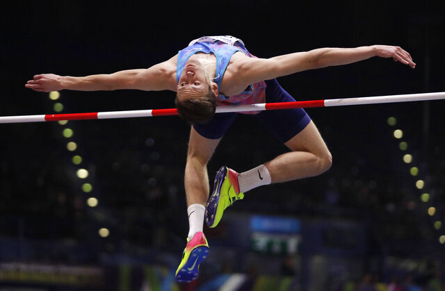 FILE - In this March 1, 2018, file photo, Russia's Danil Lysenko competes in the men's high jump final at the World Athletics Indoor Championships in Birmingham, England. Sports authorities heightened the possibility of completely excluding Russian track athletes from this year's Olympics in the wake of a spate of doping scandals that have engulfed the country. The Athletics Integrity Unit, which handles doping-related matters for World Athletics, said Wednesday, Jan. 29, 2020, it made the recommendation after not getting appropriate responses from Russia's track and field federation (RusAF) regarding a case involving forged documents for high jumper Danil Lysenko. (AP Photo/Matt Dunham, File)