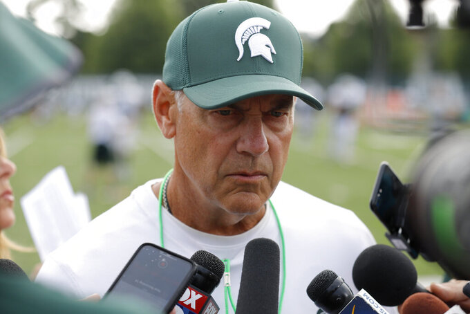 FILE - In this Aug. 12, 2019, file photo, Michigan State coach Mark Dantonio talks to reporters during the NCAA college football team's practice in East Lansing, Mich. Michigan State went 7-6 last season and scored only 32 points over its final four games. Even so, the Spartans are ranked 18th in the AP's preseason poll. Although there are plenty of questions surrounding Dantonio's team, it feels like voters decided to give Michigan State the benefit of the doubt for now. (AP Photo/Al Goldis, File)