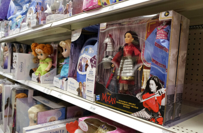 """A doll based on the upcoming Walt Disney Studios film """"Mulan"""" is displayed in the toy section of a Target department store, Thursday, April 30, 2020, in Glendale, Calif.  Despite film delays, toy production and gaming companies are staying on schedule, releasing a variety of products tied to major titles in hopes of weathering through the pandemic. Most products are already in retail, appearing on store shelves and being sold online several months to a year ahead of the film's new release date. (AP Photo/Chris Pizzello)"""