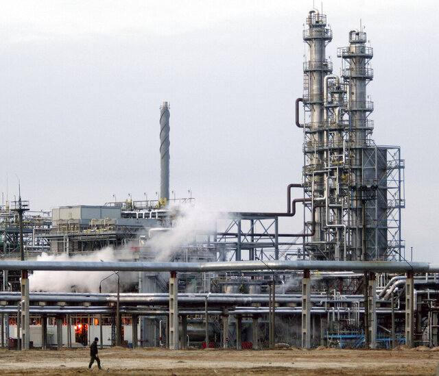 FILE - In this file photo taken on Tuesday, Jan. 9, 2006, Oil-refining plant located in Belarus's town of Mozyr, some 300 km south-east of Minsk, Belarus. Russia has halted oil supplies to Belarus Friday Jan. 3, 2020, after the two countries failed to renegotiate a contract amid talks of further improving their economic ties. (AP Photo /Sergei Grits, File)