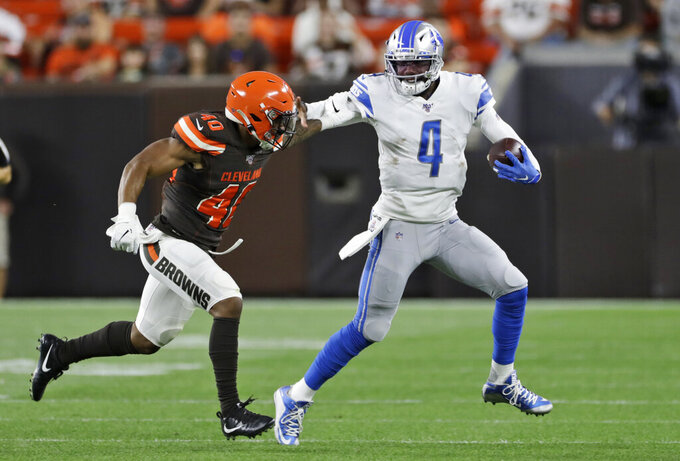 Detroit Lions quarterback Josh Johnson (4) rushes against Cleveland Browns defensive back Tigie Sankoh (40) during the second half of an NFL preseason football game Thursday, Aug. 29, 2019, in Cleveland. (AP Photo/Ron Schwane)