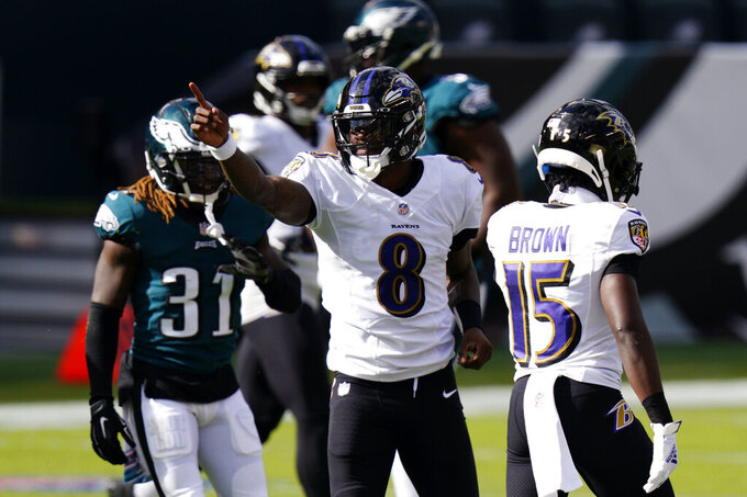 Baltimore Ravens' Lamar Jackson reacts after a run during the second half of an NFL football game against the Philadelphia Eagles, Sunday, Oct. 18, 2020, in Philadelphia. (AP Photo/Chris Szagola)