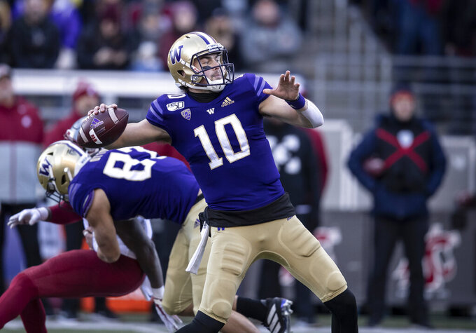 Washington quarterback Jacob Eason passes the ball during the first half of an NCAA college football game against Washington State, on Friday, Nov. 29, 2019 in Seattle. (AP Photo/Stephen Brashear)