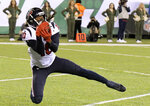 File-This Dec. 15, 2018, file photo shows Houston Texans wide receiver DeAndre Hopkins making a touchdown catch on a pass from quarterback Deshaun Watson, not pictured, during the first half of an NFL football game in East Rutherford, N.J. Hopkins has 103 receptions for 1,425 yards which ranks second in the NFL. He needs just nine catches and 97 yards receiving to surpass his career-highs of 111 receptions and 1,521 yards set in 2015. But he's not just close to outdoing his own numbers, he has a chance to pass Andre Johnson for two franchise receiving records with a big game on Sunday, Dec. 30, 2018. (AP Photo/Bill Kostroun, File)