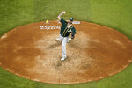 Oakland Athletics starting pitcher Mike Fiers throws to the Texas Rangers in the third inning of a baseball game in Arlington, Texas, Friday, Sept. 11, 2020. (AP Photo/Tony Gutierrez)