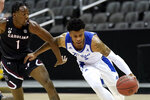 Tulsa's Elijah Joiner, right, drives under pressure from South Carolina's T.J. Moss (1) during the second half of an NCAA college basketball game Sunday, Nov. 29, 2020, at the T-Mobile Center in Kansas City, Mo. (AP Photo/Charlie Riedel)