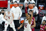 Rutgers' Jacob Young (42) puts up a shot against Indiana's Trayce Jackson-Davis (23) during the second half of an NCAA college basketball game at the Big Ten Conference tournament, Thursday, March 11, 2021, in Indianapolis. (AP Photo/Darron Cummings)