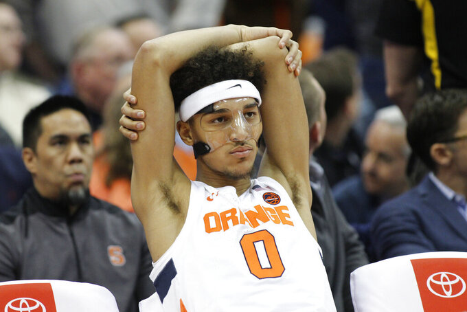 FILE - In this Feb. 11, 2020, file photo, Syracuse's Brycen Goodine reacts on the bench during the second half of an NCAA college basketball game against North Carolina State in Syracuse, N.Y. Goodine announced on his Twitter account that he transferring. (AP Photo/Nick Lisi, File)