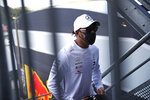 Mercedes driver Lewis Hamilton of Britain walks in the paddock prior to the Formula One Grand Prix at the Spa-Francorchamps racetrack in Spa, Belgium Thursday, Aug. 27, 2020. (AP Photo/Francisco Seco)