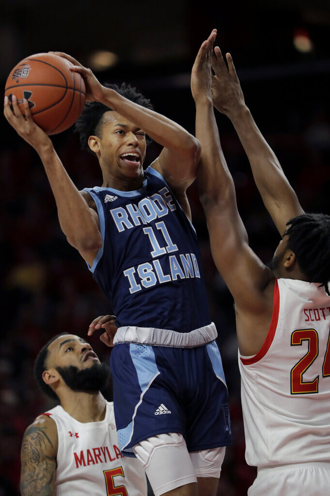 Rhode Island guard Jeff Dowtin (11) goes up to shoot against Maryland forward Donta Scott (24) during the second half of an NCAA college basketball game, Saturday, Nov. 9, 2019, in College Park, Md. (AP Photo/Julio Cortez)