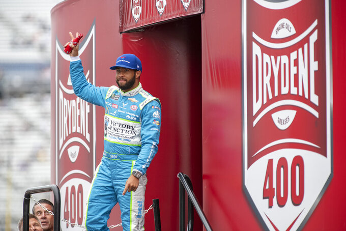 Bubba Wallace (43) walks on to the stage during driver introductions at the Drydene 400 - Monster Energy NASCAR Cup Series playoff auto race, Sunday, Oct. 6, 2019, at Dover International Speedway in Dover, Del. (AP Photo/Jason Minto)
