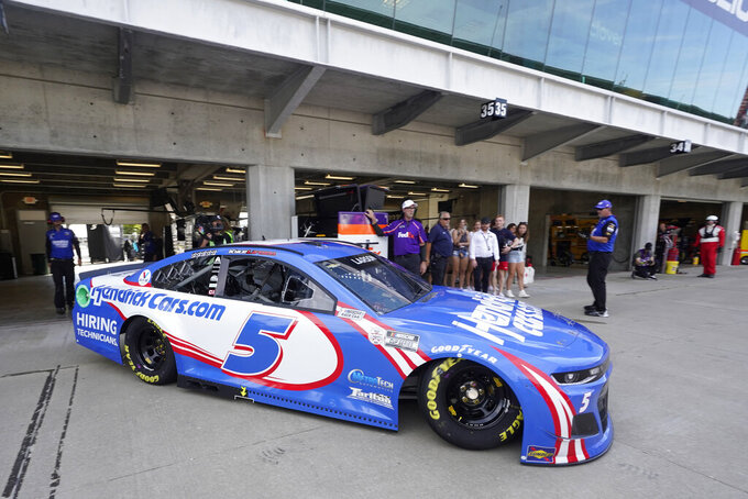 Kyle Larson pulls out of his garage during practice for the NASCAR Cup Series at Indianapolis Motor Speedway, Saturday, Aug. 14, 2021, in Indianapolis. (AP Photo/Darron Cummings)