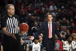 Cincinnati coach John Brannen yells at a referee after the ball was ruled last touched by Cincinnati, during the second half of the team's NCAA college basketball game against Central Florida on Wednesday, Feb. 19, 2020, in Cincinnati. (Albert Cesare/The Cincinnati Enquirer via AP)