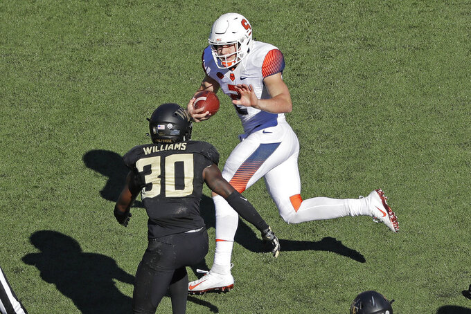 Syracuse's Eric Dungey (2) runs as Wake Forest's Ja'Cquez Williams (30) defends in the second half of an NCAA college football game in Charlotte, N.C., Saturday, Nov. 3, 2018. (AP Photo/Chuck Burton)