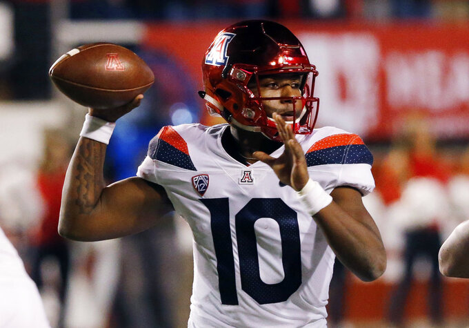 Arizona quarterback Jamarye Joiner (10) throws a pass against Utah during the first half of an NCAA college football game Friday, Oct. 12, 2018, in Salt Lake City. (AP Photo/Rick Bowmer)