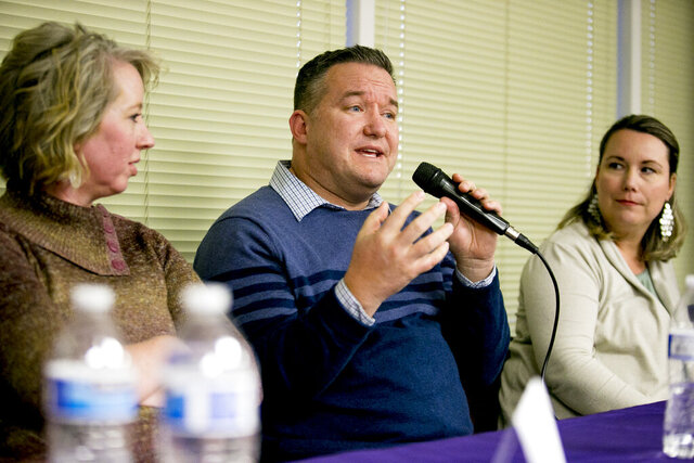 This photo taken Feb. 25, 2020, shows Arkin Hill, of West Jordan, speaking about his family's experience with foster care during a question-and-answer forum with current foster parents hosted by Utah Foster Care at the organization's state headquarters in Murray, Utah. (Isaac Hale/The Daily Herald via AP)