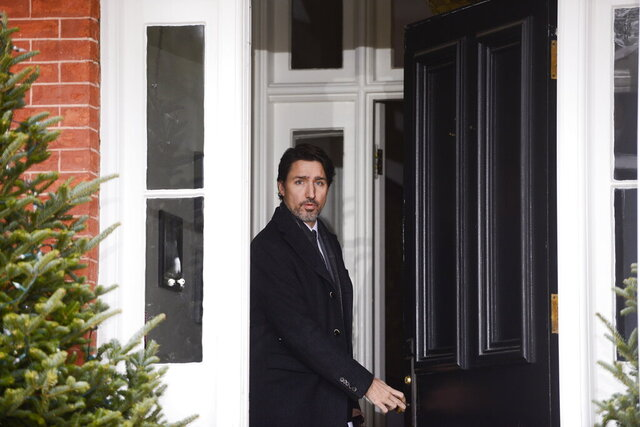 Canada Prime Minister Justin Trudeau arrives to address Canadians on the COVID-19 pandemic from Rideau Cottage in Ottawa, Ontario, Friday, April 3, 2020. (Sean Kilpatrick/The Canadian Press via AP)