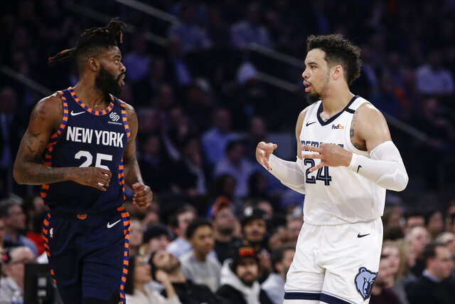 Memphis Grizzlies' Dillon Brooks (24) celebrates after making a 3-point basket as New York Knicks' Reggie Bullock (25) watches during the first half of an NBA basketball game Wednesday, Jan. 29, 2020, in New York. (AP Photo/Frank Franklin II)
