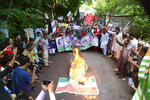 Pakistani Kashmiris stand by a burning effigy of the Indian prime minister and a representation of the Indian flag during an anti-Indian protest in Muzaffarabad, capital of Pakistani Kashmir, Tuesday, Aug. 20, 2019. Sardar Masood, the president of Pakistani-administered Kashmir has welcomed efforts by U.S. President Donald Trump to lower tensions between Pakistan and India over the disputed Himalayan region and warned of a humanitarian crisis and food shortages in the Indian-held portion. (AP Photo/M.D. Mughal)