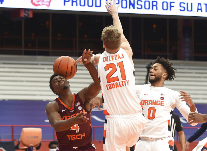 Virginia Tech guard Nahiem Alleyne (4) takes a rebound off the head  during an NCAA college basketball game against Syracuse at the Carrier Dome, Syracuse, N.Y., Saturday Jan. 23, 2021. (Scott Schild/The Post-Standard via AP)