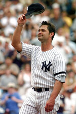 FILE - In this Sept. 2, 2000, file photo, New York Yankees' Don Mattingly tips his cap to the crowd as he is introduced for the first time during Old Timer's Day ceremonies at Yankee Stadium in New York. Mattingly returns this weekend to Yankee Stadium, where his best years as a player always ended when the regular season did. (AP Photo/John Dunn, File)
