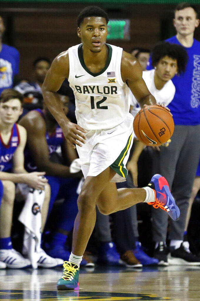 FILE - In this Feb. 22, 2020, file photo, Baylor guard Jared Butler dribbles up court against Kansas during an NCAA college basketball game in Waco, Texas. Butler was selected to the Associated Press All-Big 12 first team announced Tuesday, March 10, 2020.(AP Photo/Ray Carlin, File)