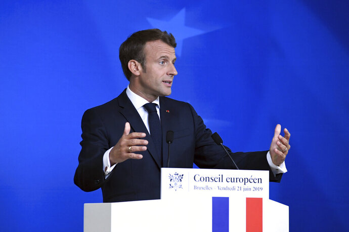 French President Emmanuel Macron speaks during a media conference at the end of an EU summit in Brussels, Friday, June 21, 2019. EU leaders concluded a two-day summit on Friday in which they discussed, among other issues, the euro-area. (AP Photo/Riccardo Pareggiani)