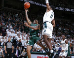 Binghamton's Sam Sessions, left, shoots next to Michigan State's Aaron Henry during the first half of an NCAA college basketball game Sunday, Nov. 10, 2019, in East Lansing, Mich. (AP Photo/Al Goldis)