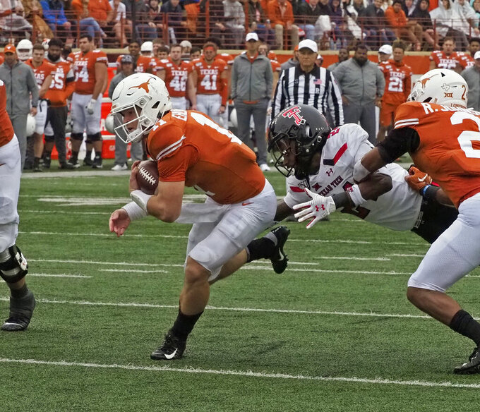 Texas quarterback Sam Ehlinger (11) runs for a touchdown during the first half of an NCAA college football game against Texas Tech, Friday, Nov. 29, 2019, in Austin, Texas. (AP Photo/Michael Thomas)