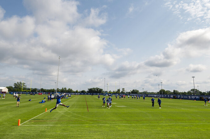 New York Giants wide receiver Sterling Shepard, left, makes a catch at NFL football training camp, Wednesday, July 28, 2021, in East Rutherford, N.J. (AP Photo/Corey Sipkin)