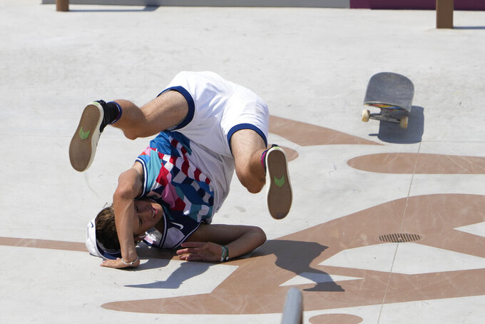 Jagger Eaton of the United States tumbles during the men's street skateboarding finals at the 2020 Summer Olympics, Sunday, July 25, 2021, in Tokyo, Japan. (AP Photo/Jae C. Hong)