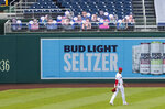 Washington Nationals left fielder Juan Soto walks near cut outs with number 22 on the bleacher during the first inning of a baseball game against the New York Mets in Washington, Wednesday, Aug. 5, 2020. (AP Photo/Manuel Balce Ceneta)