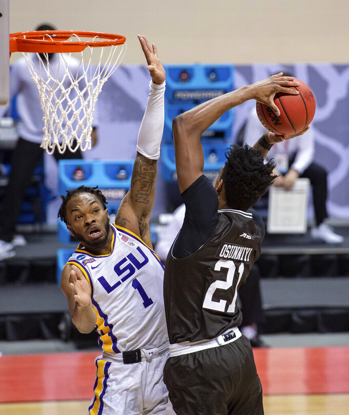 LSU guard Ja'Vonte Smart (1) attempts to block a shot by St. Bonaventure forward Osun Osunniyi (21) during the first half of a first-round game in the NCAA men's college basketball tournament, Saturday, March 20, 2021, at Assembly Hall in Bloomington, Ind. (AP Photo/Doug McSchooler)