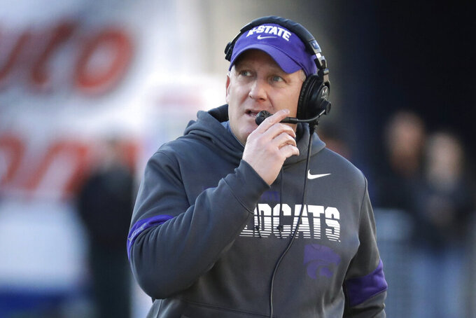 "FILE - In this Dec. 31, 2019, file photo, Kansas State coach Chris Klieman watches from the sideline during the first half of the team's Liberty Bowl NCAA college football game against Navy in Memphis, Tenn. The Big Ten and Pac-12 became the first Power Five conferences to cancel their fall football seasons because of concerns about COVID-19. The announcements left the Atlantic Coast Conference, the Southeastern Conference and the Big 12 as thePower Five conferences still intending to play in the fall, and left Klieman clinging to hope. ""I hope they don't totally lose a season,"" he said of his players. (AP Photo/Mark Humphrey, File)"
