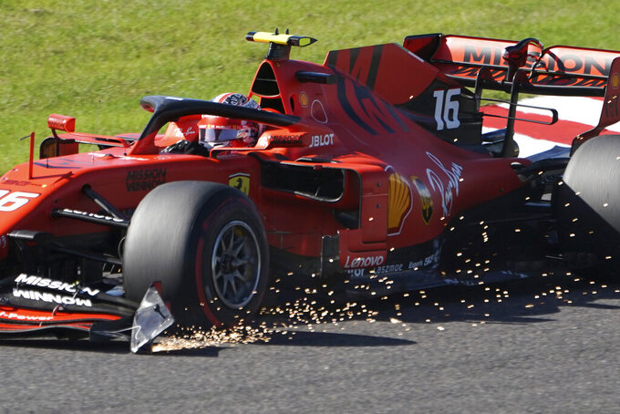 Ferrari driver Charles Leclerc of Monaco steers his car during the Japanese Formula One Grand Prix at Suzuka Circuit in Suzuka, central Japan, Sunday, Oct. 13, 2019. (AP Photo/Toru Hanai)