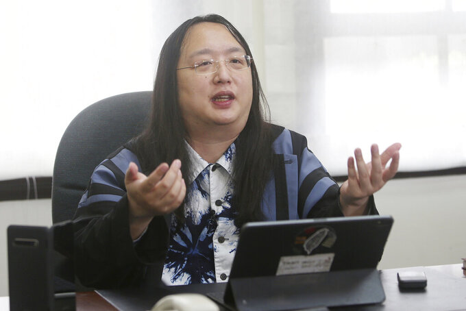 Taiwan's Digital Minister Audrey Tang speaks during an interview with The Associated Press in Taipei, Taiwan, Thursday, Dec. 10, 2020. Tang told the AP that Taiwan plans to create an independent agency to enforce digital privacy, tackling an increasingly urgent issue as countries step up surveillance during the pandemic. (AP Photo/Chiang Ying-ying)