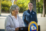 California Air Resources Board chair Mary Nichols, left, speaks as California Gov. Gavin Newsom listens at a press conference on Wednesday, Sept. 23, 2020, at Cal Expo in Sacramento where he announced an executive order requiring the sale of all new passenger vehicles to be zero-emission by 2035, a move the governor says would achieve a significant reduction in greenhouse gas emissions. California would be the first state with such a rule, though Germany and France are among 15 other countries that have a similar requirement. (Daniel Kim/The Sacramento Bee via AP, Pool)