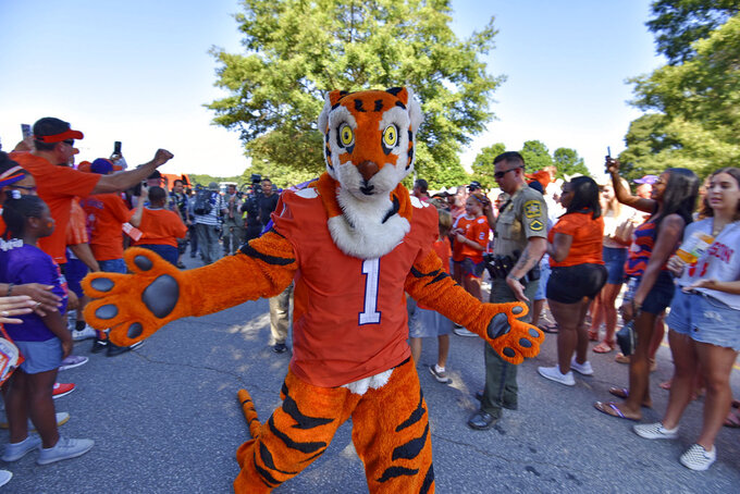 "The Clemson Tiger rallies the fans during ""Tiger Walk"" before the start of an NCAA college football game against Furman Saturday, Sept. 1, 2018, in Clemson, S.C. (AP Photo/Richard Shiro)"