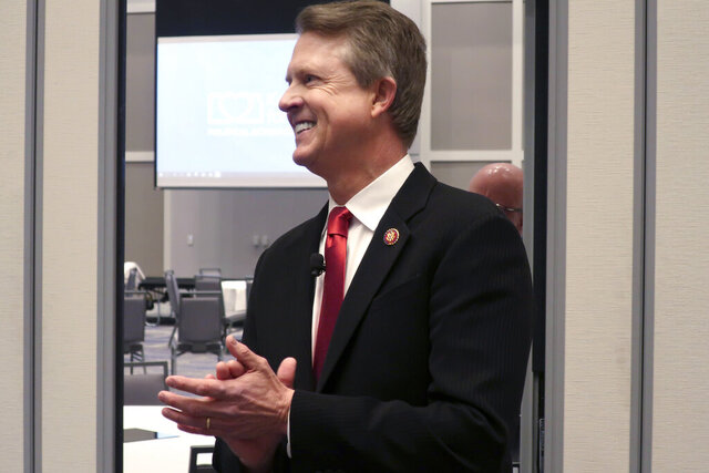 FILE - U.S. Rep. Roger Marshall, R-Kan., a candidate for the U.S. Senate, awaits the start of a debate in Olathe, Kan. in a Feb. 1, 2020 file photo. His opponent Kris Kobach, in the final days of a heated campaign is accusing Marshall, a physician, of performing an abortion. Rep. Marshall's campaign says the procedure was to end a life-threatening ectopic pregnancy and does not constitute an abortion. (AP Photo/John Hanna, File)