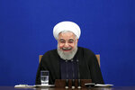 Iran's President Hassan Rouhani smiles during a press conference in Tehran, Iran, Sunday, Feb. 16, 2020. (AP Photo/Ebrahim Noroozi)