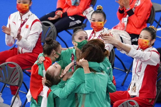 Bulgaria's rhythmic gymnastics' team, Simona Dyankova, Stefani Kiryakova, Madlen Radukanova, Laura Traets and Erika Zafirova, react after winning the gold medal for rhythmic gymnastics group all-around at the at the 2020 Summer Olympics, Sunday, Aug. 8, 2021, in Tokyo, Japan. (AP Photo/Natacha Pisarenko)