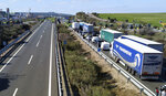 Line of vehicles are seen along the motorway as farmers protest blocking the access near Navalmoral de la Mata in Caceres province, Spain, on Tuesday, February 18, 2020. Farmers in fluorescent yellow vests have begun blocking highways in southwestern Spain with tractors and other vehicles in the latest mass protest over what they say are plummeting incomes for agricultural workers. (AP Photo/Alicia Leon)